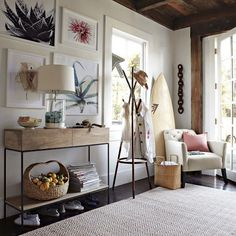 surf chic interior - love the carpet, the sideboard, the large-scale simple framed art. it all feels so light and airy