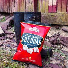 The gardener's perfect companion. #AgedWhiteCheddar #PopcornIndiana #popcorn #cheese #WhiteCheddar #snack #garden #gardening #GardenBoots #farm #FarmLife #farming #sustainable #SustainableFarm