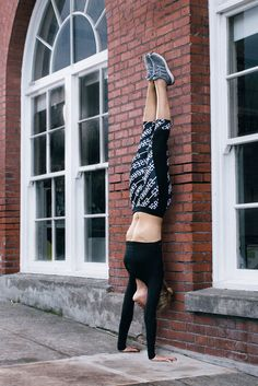 The world is your studio.  Find a wall, and improve your overall strength by holding a handstand for as long as you can!  Click through to get the gear you need.