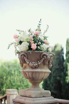 Greek style urn with pink and white floral for wedding. http://www.stylemepretty.com/2013/09/18/sierra-madre-wedding-from-closer-to-love-photography/