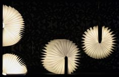 the pop up paper book lamp 'lumio sf' is a wood-covered book that turns on when users open it.