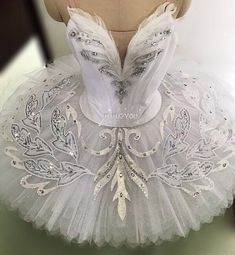White professional ballet tutu decorated with feather, beads and laces which give it a rich and vivid feeling. Perfect for white swam variations. There might be minor variation in final product due to lace batch changes. Please provide the following measurements: 1. Height (cm)