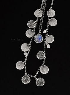 13 Moons by Aga Sobel. metal clay silver, sterling silver, moonstone.