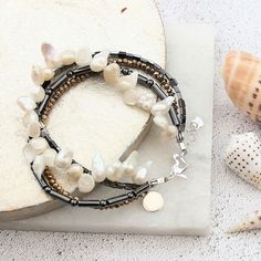 I wear one of these bracelets all the time. As my initials are SJ I can fit both of them on the silver charm. I can't always fit 2 initials on a charm but luckily I can mine!I know these are black pearls but I couldn't resist showing it to you