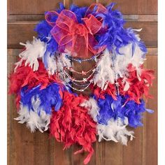 Super cute wreath idea!  Patriotic Feather Boa with Red White and Blue Star Beads- simple and adorable!