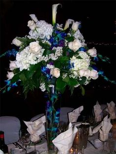 Blue Wedding Flowers, love the peacock look in the vase, and maybe a shorter vase, but like this arrangement of flowers.