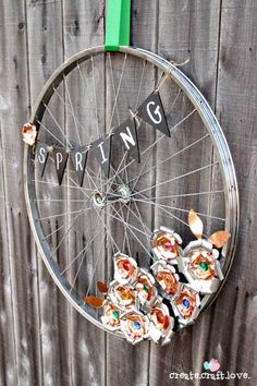 It's time for another inspirational repurposing post! This month, in honor of summer {or the end of it}, I'm sharing 14 ways to repurpose a bicycle wheel! You could grab that old bicycle wheel and Bicycle Crafts, Bicycle Decor, Old Bicycle, Bicycle Rims, Bicycle Wheel, Bicycle Art, Old Bikes, Bike Wheels, Wall Mount Bike Rack