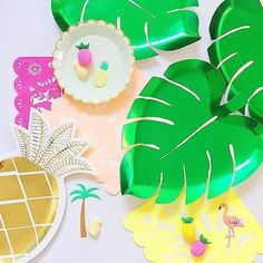 Tropical party with palm leaf and pineapple plates
