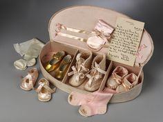 baby's keepsake box filled with shoes and socks w/provenance ... photo courtesy the Victoria and Albert Museum, London England