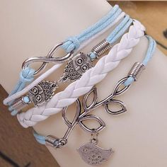 Description:Great gift for your loved ones! This product features a baby blue string & white leather bracelet with vintage metal owl & bird design pendants.Main Features:Adjustable by hooking on to different chain to fit all si...