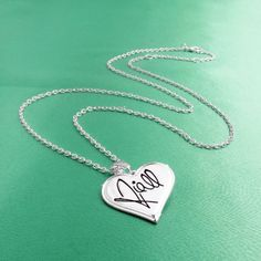 One Direction 'Niall Signature' Heart Necklace: Jewelry: Amazon.com
