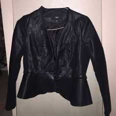 Leather jacket NEVER BEEN WORN. Black. Arm is upper leather and material lower. Tulip or Ruffled bottom. Great with jeans or dress. Really convincing faux leather Mossimo Supply Co Jackets & Coats