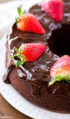 This easy Chocolate Pound Cake recipe is rich, fudgy and topped with a homemade chocolate ganache. With a some whipped cream and strawberries, this decadent chocolate fudge pound cake is out of this world. Chocolate Ganache Cake, Chocolate Pound Cake, Chocolate Sweets, Decadent Chocolate, Homemade Chocolate, Melted Chocolate, Chocolate Fudge, Chocolate Recipes, Spring Desserts