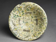 Bowl with animals and plants, Iran, 10th century (AD 901 - 1000) © Ashmolean Museum, University of Oxford http://jameelcentre.ashmolean.org/object/EA2005.42