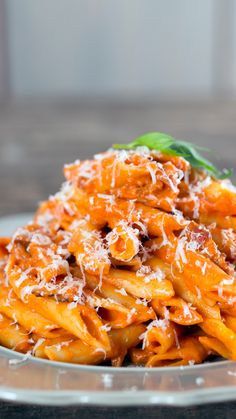 Recipe with video instructions: An updated, simple twist on this classic Italian pasta dish.  Ingredients: ½ Tbsp olive oil, 2 thick-cut slices of bacon, sliced, 2 shallots, halved and sliced, ½ lb mezze penne, 4 cups vegetable stock, or enough to cover the pasta, ½ cup tomato puree, 2 oz vodka, 1-2 Tbsp cream, Pecorino Romano