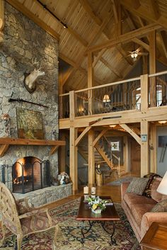 Great room photo in a red oak Woodhouse timber frame home