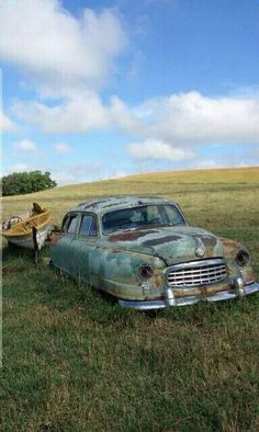 Rare find. Yes, very rare to find an abandoned 1948 Hudson in the middle of nowhere with a boat of the same era still attached.