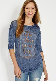 "<ul><b>Overview</b><li>soft and lightweight burnout material</li><li>needs layering</li><li>unlined lace shoulders and back yoke</li><li>""let the stars light your way"" goldtone metallic graphic text</li><li>3/4 length drop shoulder sleeves</li><li>high-low shirt tail style hem</li><li>2 1/2 inch side slits</li></ul><ul><b>Fabric and Care</b><li>Style Number: 84383</li><li>Imported</li><li>62% polyester 38% cotton</li><li>machine wash</li></ul>"