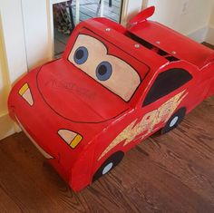 Lightning McQueen Halloween costume made from cardboard and paper mache