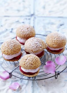 Rose and almond choux buns: Bite-sized rosewater cream buns, designed to impress. A new way to use choux pastry, these crumble-topped treats are a doddle once you've mastered the choux.