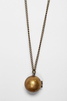Lockets have gone way in the digital photo age but there's something romantic abou them and this fresh take of a glob version.  $39 at Urgant Outfitters - Metal Ista for Urban Renewal Globe Locket Necklace