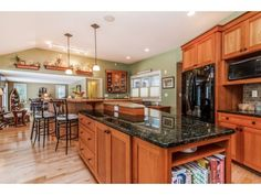 Pretty woodworks and colors in this #Kitchen