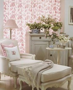 shabby chic bedroom with chair and large ottoman. Cozy reading space.