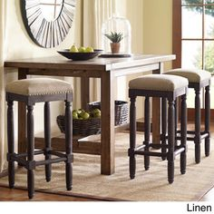 @Overstock - Renate Coffee Bar Stools (Set of 2) - Bring urban style to your home bar or kitchen counter space with these charming Renate coffee bar stools. Designed with a durable wooden frame, beveled legs and cushioned seats, these stools are upholsted in linen or grey-tone fabric with nail head trim.  http://www.overstock.com/Home-Garden/Renate-Coffee-Bar-Stools-Set-of-2/8699295/product.html?CID=214117 $199.99