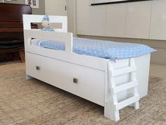 Is your toddler still sleeping with you & you love them too much to let go?  The Co-sleeper for toddlers is a simple and practical bed that helps the whole family get a full night's sleep.  The Co-sleeper is a custom made toddler bed that matches the parent's bed in height and entry. With this bed your little one has his own space but is still right next to you, just an arm's length away.   The co-sleepers shown are also available in standard bed designs for the independent toddler.