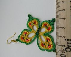 These funny earrings Rainbow Butterfly were tatted with 100% cotton thread yellow and green color with beads. You can were them with