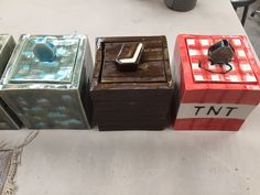 3/3 minecraft boxes:  diamond ore with diamond, wood planks with book, tnt with gun powder.