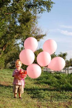 Baby girl gender reveal photo ... pink balloons and flowers!