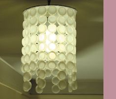 bottle-cap-lampshade by Annika McStabbinsons, via Flickr - so time consuming but so cool !