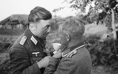 German soldiers drink schnapps.