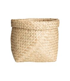 Natural. Small storage basket in braided straw. Height 7 1/2 in., diameter 9 in.