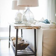 Ashley Gilbreath - living rooms - rustic console table, distressed console table, reclaimed wood console table, metal base console table, recycled glass lamps, trough tray, seashells,