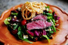 big steak salad with buttermilk onion rings and candied pecans