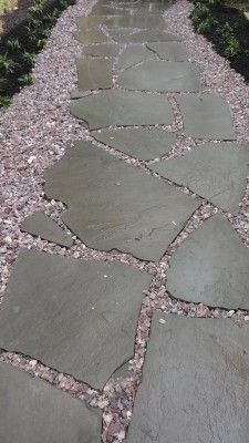 """Install """"chipped"""" gravel and irregular flagstone in areas where grass won't grow."""
