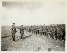 "Soldiers of the 1st Canadian Infantry Brigade marches past Sam Hughes, the Minister of Militia and Defence, and Major-General Arthur Currie in the summer of 1916. Canadian troops were known by the British Tommies as ""fuckin' five bobbers,"" as they received almost five times the pay of their British counterparts."