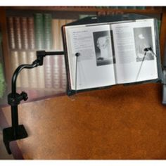 The LEVO Desk Book Holder rotates 360 degrees so you can swing your book out of your way when you're finished reading. Book holder clamps on to your desk to provide hands free reading. Book Holder For Desk, Book Holders, Neck Strain, Cookbook Holder, Crystal Springs, Book Stands, Office Set, Good Posture, Construction Materials