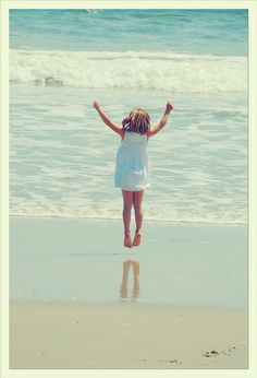 jumping for joy at the seashore!