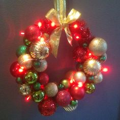 Wreath with lights christmas colours red, green, gold made by me
