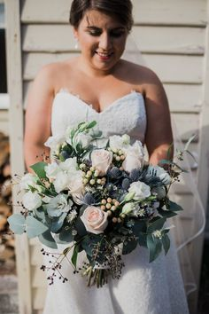 My large but beautiful wedding bouquet. Juliet roses, Sea Holly, Hypercuim Berries, Blue Gum, Easter Daisies, Privet Berries. Love Love Love. Wedding flower Perfection! Rose Gold and Navy Wedding