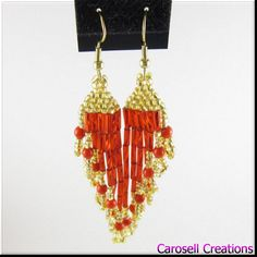 Beaded chandelier dangle red and gold earrings. These are made by weaving seed, bugle and 4mm party beads together in this colorful design. The party beads are a swirl of red and gold colors mixed together that really add to making this piece shine. These are light weight for comfortable wear. Pierced earrings come with a clear plastic backing highly effective in preventing loss of earrings. Ear wire can be exchanged to lever back or clip on style if desired. Please specify if there needs to…
