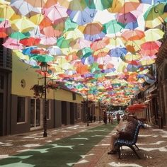 Águeda, Portugal Águeda's Umbrella Sky Project began in 2011 as a part of the Portuguese city's annual Ágitagueda Art Festival. Beautiful Streets, Most Beautiful, Beautiful Places, Saint Marin, Places To Travel, Places To Go, Travel Destinations, Umbrella Street, Umbrella Art