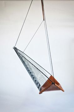 Side view Solo Cello Hanging Chair by les Ateliers Guyon //lines, black, wood, string, minimal