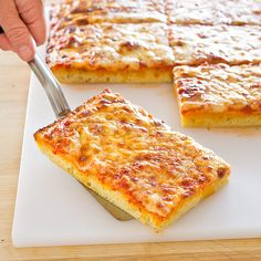 Thick Crust, Sicilian Style Pizza by Cook's Illustrated --Dense, doughy slabs of thick-crust pizza are all too familiar—and forgettable. We wanted to give the real-deal Sicilian pie its due. Sicilian Style Pizza, Pizza Recipes, Cooking Recipes, Cooking Videos, Bread Recipes, Yummy Recipes, Dinner Recipes, Healthy Recipes, American Test Kitchen