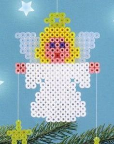 Christmas angel hama beads hang stars on strings from hands Perler Bead Designs, Hama Beads Design, Diy Perler Beads, Perler Bead Art, Fuse Bead Patterns, Perler Patterns, Beading Patterns, Bracelet Patterns, Embroidery Patterns
