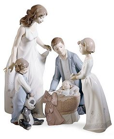 """Show Mom some love. Handcrafted in premium porcelain, the Wonderful Mother figurine from Lladro is a beautiful addition to any family setting. 