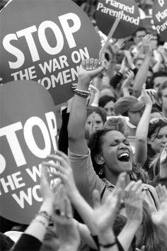War on Women - Aisha Bain, 25, center, of New York City, joins thousands of fellow protesters in Washington, D.C., Sunday, April 25, 2004 during the